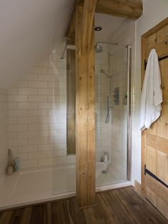 Border Oak - oak post with shower enclosure behind.