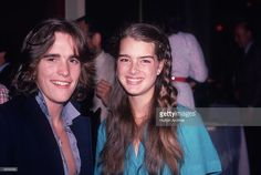 American actors Matt Dillon (L) and Brooke Shields smile for photographers at Dillon's sixteenth birthday party, February 1980. Dillon has feathered hair, and wears his shirt collar turned up.