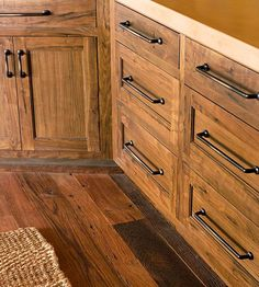 Strip & Stain Wood Cabinets--need to do this in both bathrooms and the kitchen. Wonder how long that would take? Also would need to redo the facings.