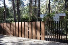 "Image 8 of 14 from gallery of This New ""Fancy Fence"" System Retracts Gate Directly Into Ground. Courtesy of Fancy Fence Fancy Fence, Small Fence, Front Yard Fence, Low Fence, Horizontal Fence, Fence Doors, Fence Gate, Wire Fence, Cedar Fence"