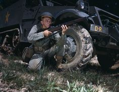An infantryman crouches beside a half-track with an M1 Garand. (Photo via Library of Congress)  via @AOL_Lifestyle Read more: https://www.aol.com/article/news/2017/03/02/spectacular-color-photos-capture-wwii-tank-crews-in-training/21721594/?a_dgi=aolshare_pinterest#fullscreen