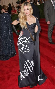 WORST: Madonna in Moschino. I don't like it because she looks like she just ruined a pretty black dress with white spray paint and added gloves and a purse.