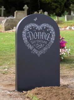 Wow - love the dates written int he shape of the heart!    Decorative Headstone example with hand carved butterly and flowers.