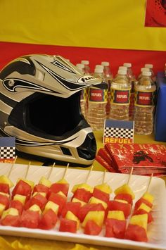 Love the idea of using a helmet to decorate food table with