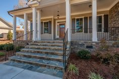 Exquisite stone accents add a welcoming touch to the front porch of the Mount Vernon plan, a new home by Ivey Residential. The River Island community. Evans, GA.