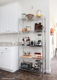 Add an Extra Cabinet on that Weird Kitchen Wall, instead of waiting until after the house is built. (so no metal shelves like this one) Kitchen Shelving Units, Kitchen Organisation, Diy Kitchen Cabinets, Kitchen Storage, Kitchen Dining, Kitchen Decor, Kitchen Bookshelf, Kitchen Laminate, Laminate Countertops