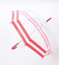 Get ready to withstand sun-showers, light rain and down pours - in style! This clear umbrella features bold red stripes and an easy push button - perfect for little hands to open and close.