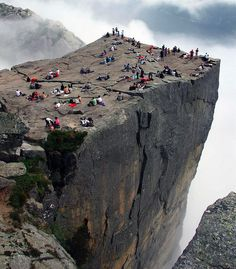 "norway: ""Lodging in the remote, rustic chic Storfjord Hotel, hiking through jutting fjords and dramatic gorges, biking alongside pristine lakes, maybe even an adventurous glacier safari. And let's not forget, a hike to Preikestolen, for a picnic with an amazing view."