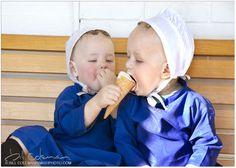 little Amish girls having a treat