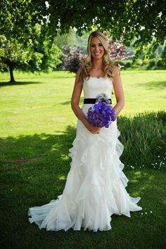 "Augusta Jones ""Waverly"" wedding gown with black belt and love the stunning blue flowers in contrast"