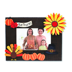 Create custom frames for all occasions. Change out colorful magnets and favorite photos for unique year round displays. Thanksgiving Magnets and Dimensional Sunflower Magnet from Embellish Your Story by Roeda.