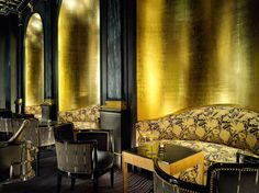 The Beaufort Bar in London's iconic Savoy Hotel. The new Beaufort bar incorporates the hotel's former cabaret stage (graced by the likes of George Gershwin and Carol Gibbons) as the centrepiece to a theatrical, art deco space, with sumptuous black velvet furnishings and £ 40,000 of gold leaf on the walls.