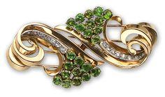A diamond and demantoid garnet double-clip brooch