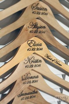 A lovely gift of a personalized wood dress hanger for your attendants!