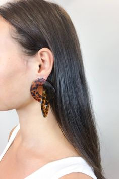 These chunky leopard print jewel statement dangling earrings are exactly what you need to dress up that Summer 2018 outfit.