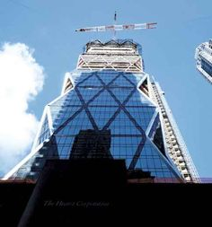 Rising among the staid rectangular buildings of midtown Manhattan is an anomaly in the urban landscape: a sleek, faceted skyscraper glittering above a squat, ornate plinth. Architecture critic Paul Goldberger calls the new Hearst Tower the most beautiful