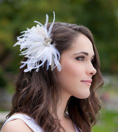 Swap out the veil for a feather fascinator at the reception!