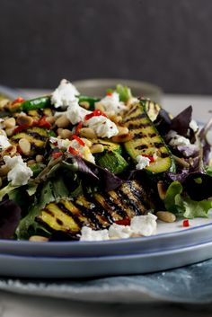 Marinated zucchini salad with goat's cheese and pine nuts