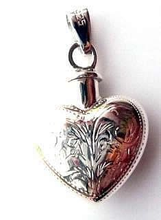 A wide range of sterling silver lockets, traditional opening designs with and without engraving for photographs. Ashes/ Perfume and keepsake lockets also available.