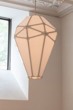 Australian designer Mary Wallis is displaying the faceted, white glass Empire chandelier