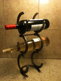 Horse shoe Rustic Western Wine Rack. $30.00, via Etsy.
