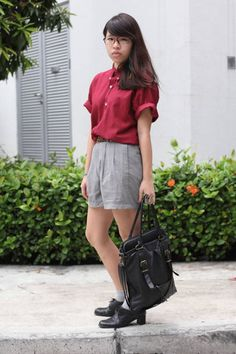Singapore Who : Yuanyi What : Geek-chic never looked so cool—don a loose button-down shirt and pleated pants for a stylish daily look. Wear : Top and pants from local boutique, vintage shoes   Read more: Global Street Style - Discover More Street Style  Follow us: @ElleMagazine on Twitter | ellemagazine on Facebook  Visit us at ELLE.com