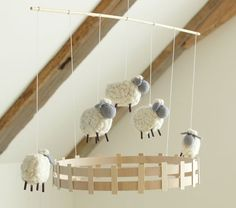 Sheep Mobile. Popsicle sticks, string, sticks, fluff etc.Very cute!! No nursery needed. Would look sweet in a craft room corner