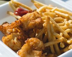 Sitting on the dock of the bay, or a patio downtown, or in the cool comfort  of an air conditioned restaurant, nothing says summertime like fish and  chips.  Here are the city's top 5 spots:  Fresco's Fish & Chips  213 Augusta Ave Toronto, ON  A light batter and even lighter fish is s