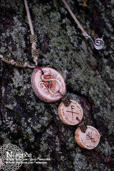 This necklace consists in three wood pendants. The biggest one has been pyrographed with a viking dragon. The second one has a bindrune, a magic symbol that gives protection. This one encourages good luck, and the third one it´s for personal protective power. Viking dragon pendant by LuthienSecrets. http://www.deviantart.com/art/Viking-dragon-pendant-347043539