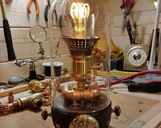 Handmade lamp in steampunk style. Electric cable in red silk.