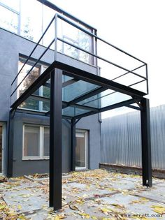 This private backyard is rejuvenated by the presence of this freestanding structure that creates a canopy for the ground floor and balcony for the second. The structure stands almost daintily on the adjustable feet integrated into the legs. Blackened steel I-beams and structural steel harmonize with the clean lined architecture. Tempered glass provides unobstructed views through the landing.: