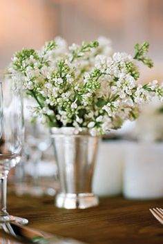 Love Stock.  So soft and pretty.  Centerpiece: stock flowers or babys breathe in silver vases