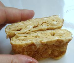 100 calorie 1 egg tamagoyaki (Japanese omelette), the slightly sweet rolled Japanese omelette, is a standby protein item for bentos. It tastes great at room temperature, is fairly easy to make (once you've done it a few times), and is cheap too.