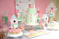 Pink and Mint Birdie 1st Birthday Table  Styling: Sugar Coated Candy & Dessert Buffets  Custom Designed Bird garland (on backdrop): Red elephant creative