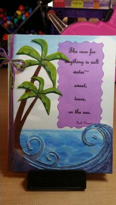 Card by Claire Morrison: The cure for anything ... Darice embossing folder Palm Tree and Wave used with inks, then cut out. Sentiment printed on vellum and cut out with Fiskars decorative scissors. Ocean and clouds background done with Gelatos.