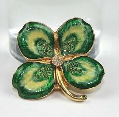 Charming four leaf clover Estee Lauder compact decorated with sparkling crystals all glittering with good fortune.