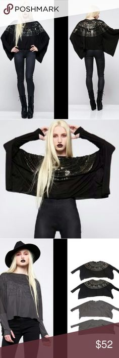 Dolls Kill Astrology Top Star Signs Widow Bat Wing Star sign top from Dolls Kill by House of Widow, formerly run by Lip Service.  Star chart graphic on the top that goes all the way around.  Super flowy!  It's like a mix of a long sleeve tee & a cape giving you a rad silhouette that moves with you when you walk.  Black fabric with a matte black foil print.  The print looks almost silver when it hits the light just right, but it is black.  Cropped  Great pre-owned condition!  All tags are…