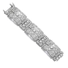 Diamond bracelet, 1930s Of geometric design, set throughout with circular-, carré-, single-cut and baguette diamonds, length approximately 185mm, French assay and partial maker's marks, one small diamond deficient.