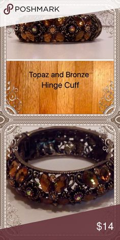 Fashion Hinge Cuff Beautiful costume cuff with topaz colored stones set among a bronze cuff that opens on a spring hinge. Great condition and all stones present. Jewelry Bracelets