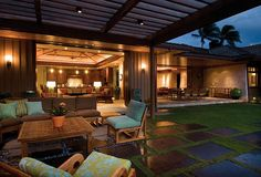 This amazing patio enclosure and backyard features garden pavers, wicker furniture and large sliding doors that while open, let's you see for miles. See the 9 essential decor items you need for your patio! Veranda Design, Terrasse Design, Diy Terrasse, Veranda Ideas, Patio Interior, Interior Exterior, Exterior Design, Patio Tropical, Tropical Houses