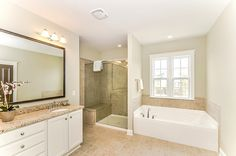 The new Master Bathroom has a wall separating the bath and shower like this... But the shower has a CURTAIN! Wth?