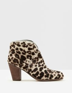 Marlow Ankle Boots Snow Leopard Women Boden, up everyday outfits with these heeled boots. Featuring a flattering V-cut and handy zip with a colourful grosgrain tie, theyre the perfect partners for skinny jeans, tunic dresses¦ Block Heel Boots, Heeled Mules, Heeled Boots, Shoe Boots, Shoe Bin, Designer Boots, Party Shoes, Marlow