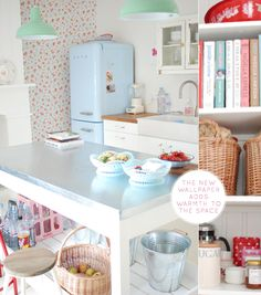A Pastel Coloured Kitchen. lamps. sink. wood countertops. zinc table