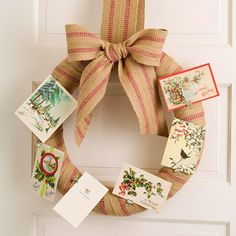 Cute way to display your Christmas cards - upholstery webbing wrapped straw wreath.