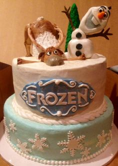 A beautifully done Disney's Frozen birthday cake.