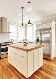 white cabinets with light sand coloured counter top. | dream