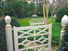 Colonial Williamsburg Garden...love the finial and white against the green.
