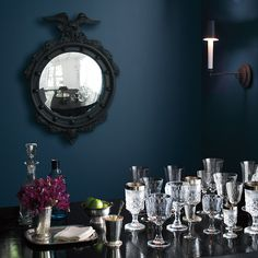Benjamin 2017 Paint Color Collection.  So many gorgeous colors! Love this table with a variety of glasses against a deep blue wall.