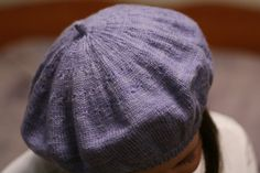Periwinkle beret.  Love love love berets - almost as much as stripes.  Or cables.  Or 3/4 sleeves.....