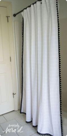 DIY Home Decor ~ Add interest to a plain shower curtain by hot gluing pom pom trim to the edges. {Ballard Designs Knock Off}